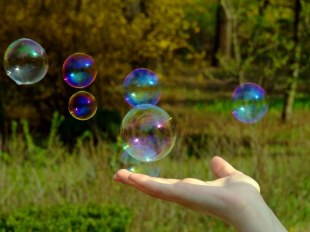 Hand-holding-a-soap-bubble